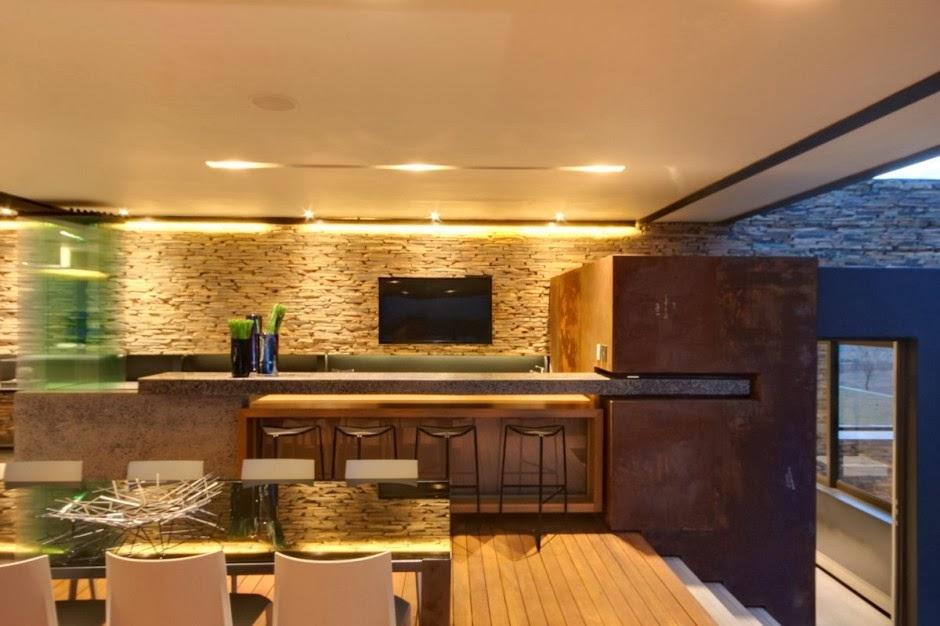 El lujo en acero y piedra casa boz nico van der meulen for Paredes de cocinas modernas