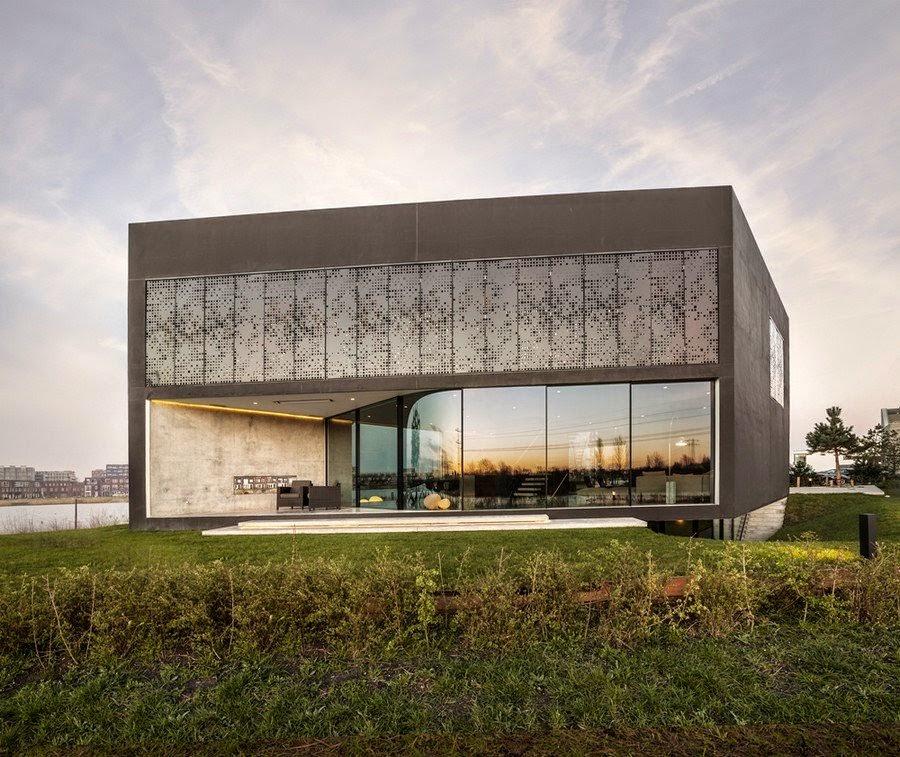 casa-moderna-fachada-hormigon-visto-y-cristal