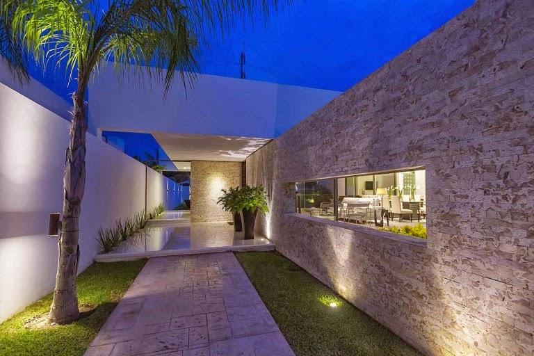 Casa minimalista dise o moderno de l neas puras arquitexs for Casas modernas revestidas en piedra