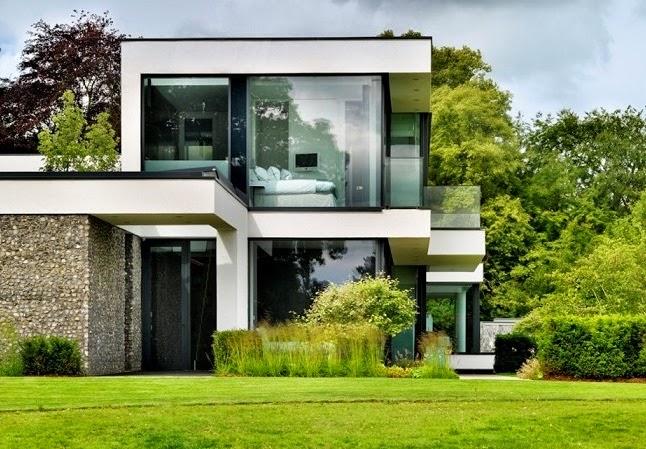 Casa de campo moderna a orillas del r o t mesis arquitexs - Piedras para fachadas de casas modernas ...