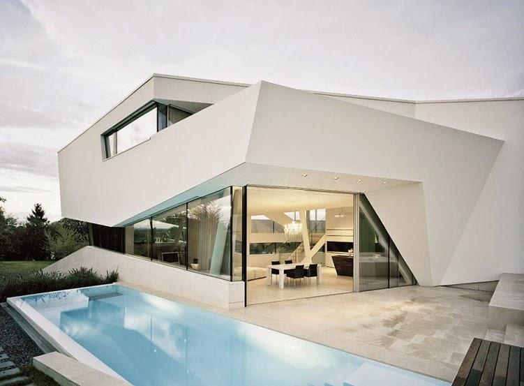 segn los arquitectos de project a01 la vivienda se encuentra sobre una ladera expuesta donde el gran jardn se funde en los campos de los alrededores y - Diseo Minimalista