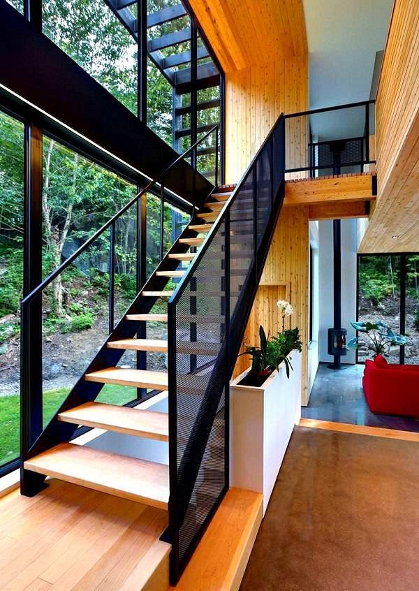 Casa de madera en el coraz n del bosque laurentian arquitexs for Casa minimalista bosque