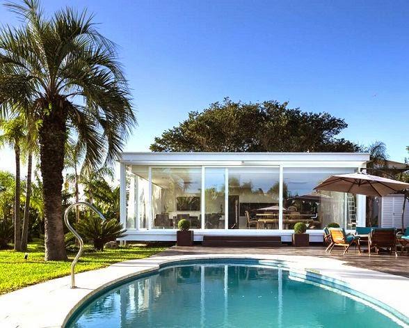 Fascinantes vistas casa moderna con piscina en porto for Casas modernas brasil