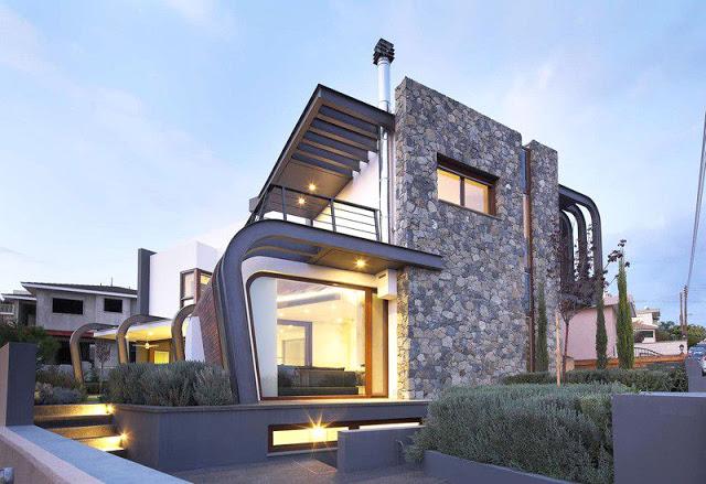 Casa moderna de estructura expuesta en chipre arquitexs for Casas modernas revestidas en piedra