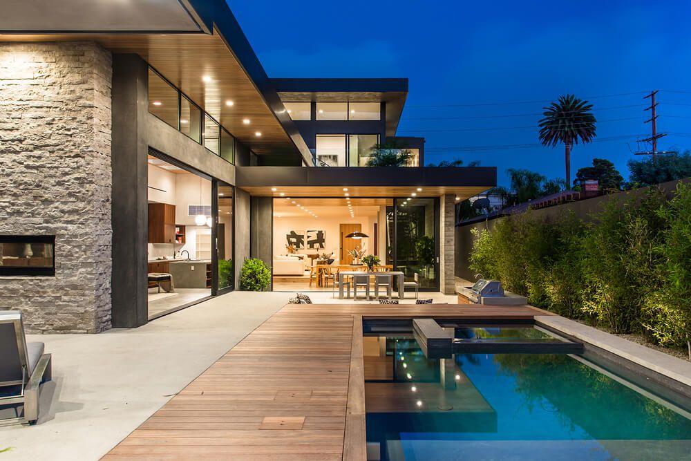 Fachada moderna casa con piscina los angeles arquitexs for Fachadas de casas modernas con alberca