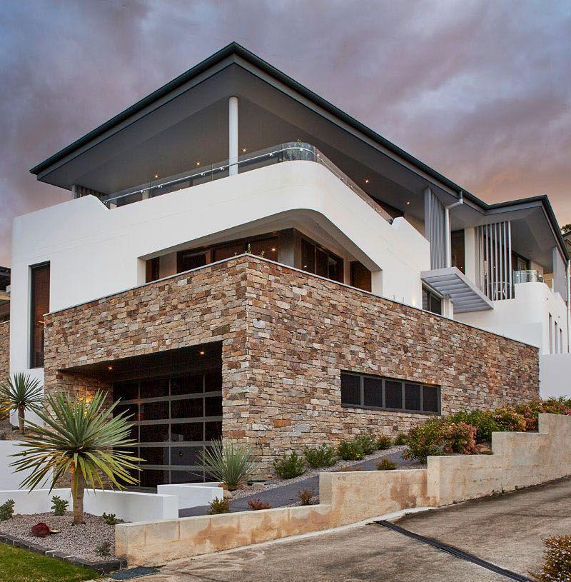 Moderna casa con fachada de piedra en australia arquitexs for Piedras para fachadas minimalistas